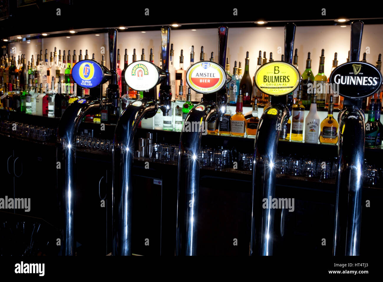 Beer taps in a bar in England - Stock Image