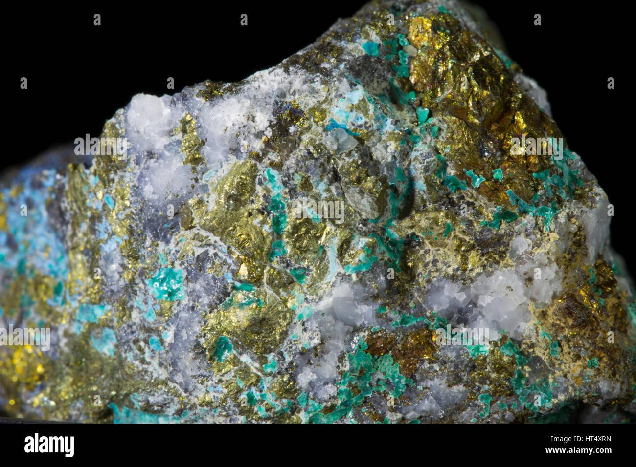 Chalcopyrite (copper iron sulphide) and Malachite (copper carbonate) minerals on quartz. From the Daren Mine , Ceredigion, - Stock Image