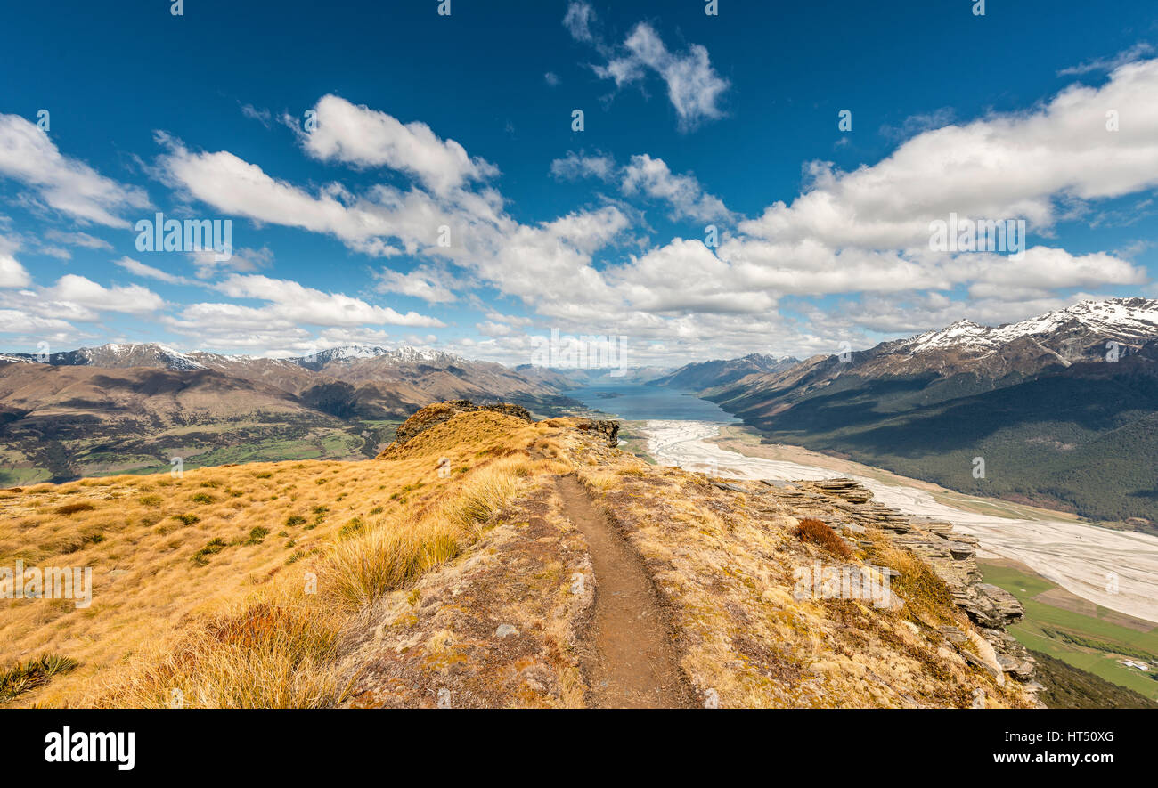 Hiking trail, view of Lake Wakatipu from Mount Alfred, Glenorchy at Queenstown, Southern Alps, Otago, Southland, - Stock Image