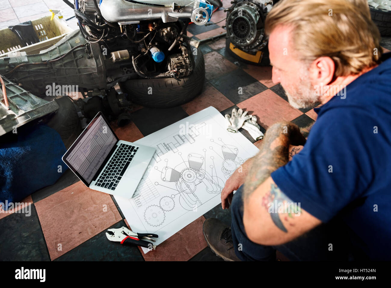 Construction Master Plan Draft Blueprint Male Laptop Concept - Stock Image