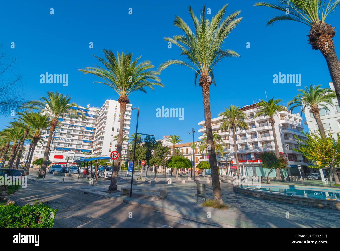 Sant Antoni De Portmany, Ibiza, November 6th, 2013:   Tourism in Spain.  People wait at a taxi stand.  Palm tree - Stock Image