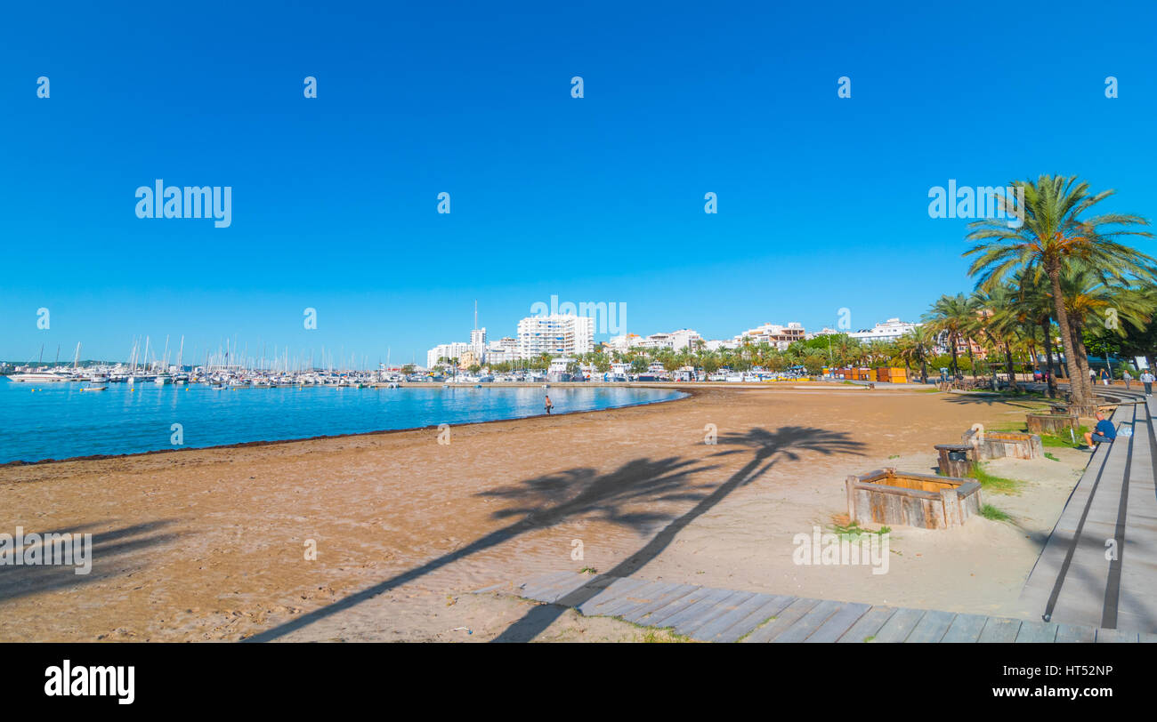 Ibiza sunshine on waterfront in Sant Antoni de Portmany,  Take a walk along main boardwalk, now a stone concourse, - Stock Image