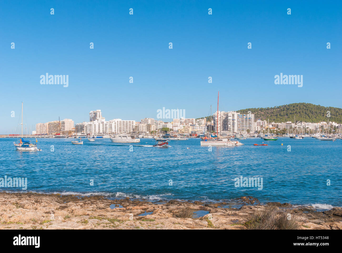 Boats in Ibiza marina harbour in the morning of a warm sunny day in St Antoni de Portmany, Balearic Islands, Spain. - Stock Image