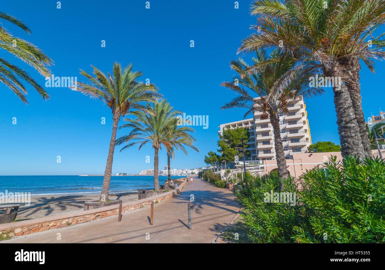 Ibiza sunshine on the bay in St Antoni de Portmany,  Ibiza,  Balearic Islands, Spain.  Hotels along the shoreline - Stock Image