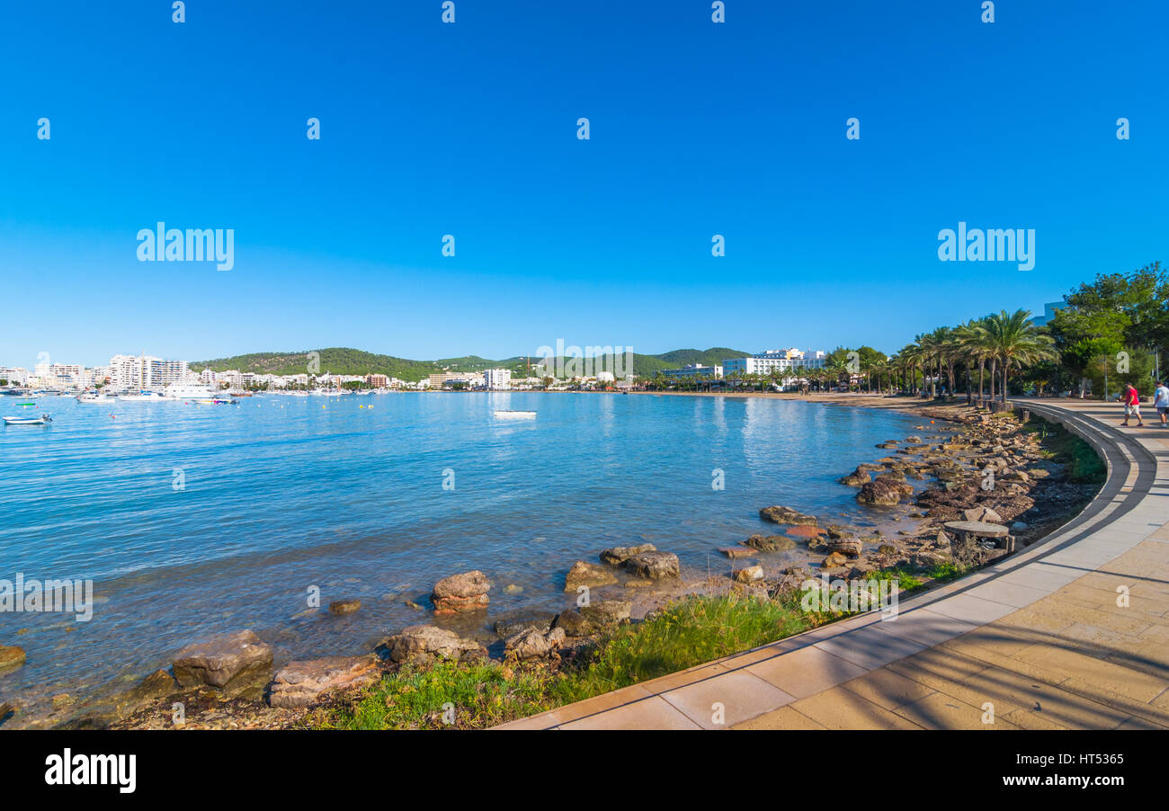 Ibiza sunshine on waterfront in Sant Antoni de Portmany,  Take a walk along main boardwalk, now a stone concourse, - Stock Image