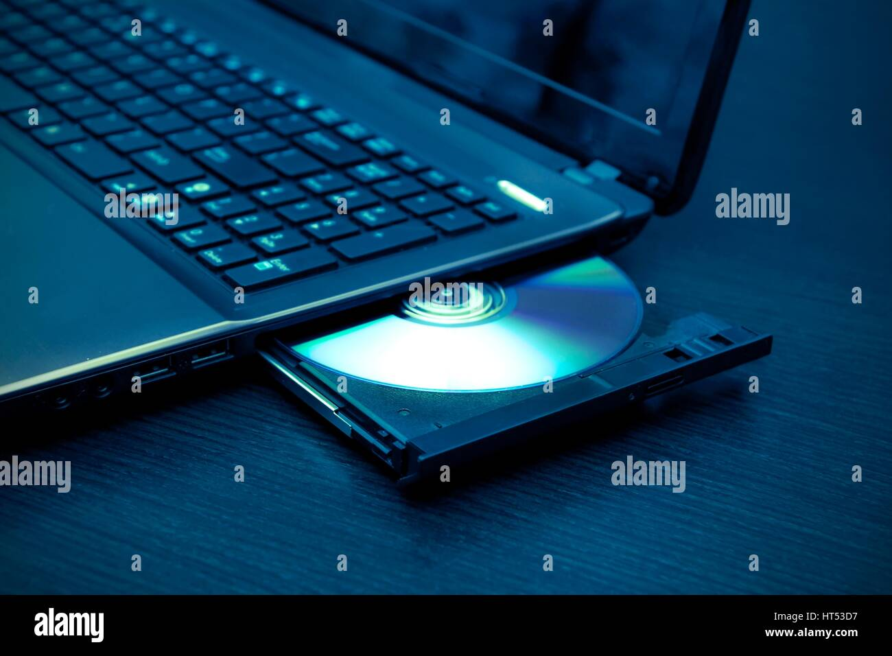 laptop with open cd dvd drive abstract light composition stock