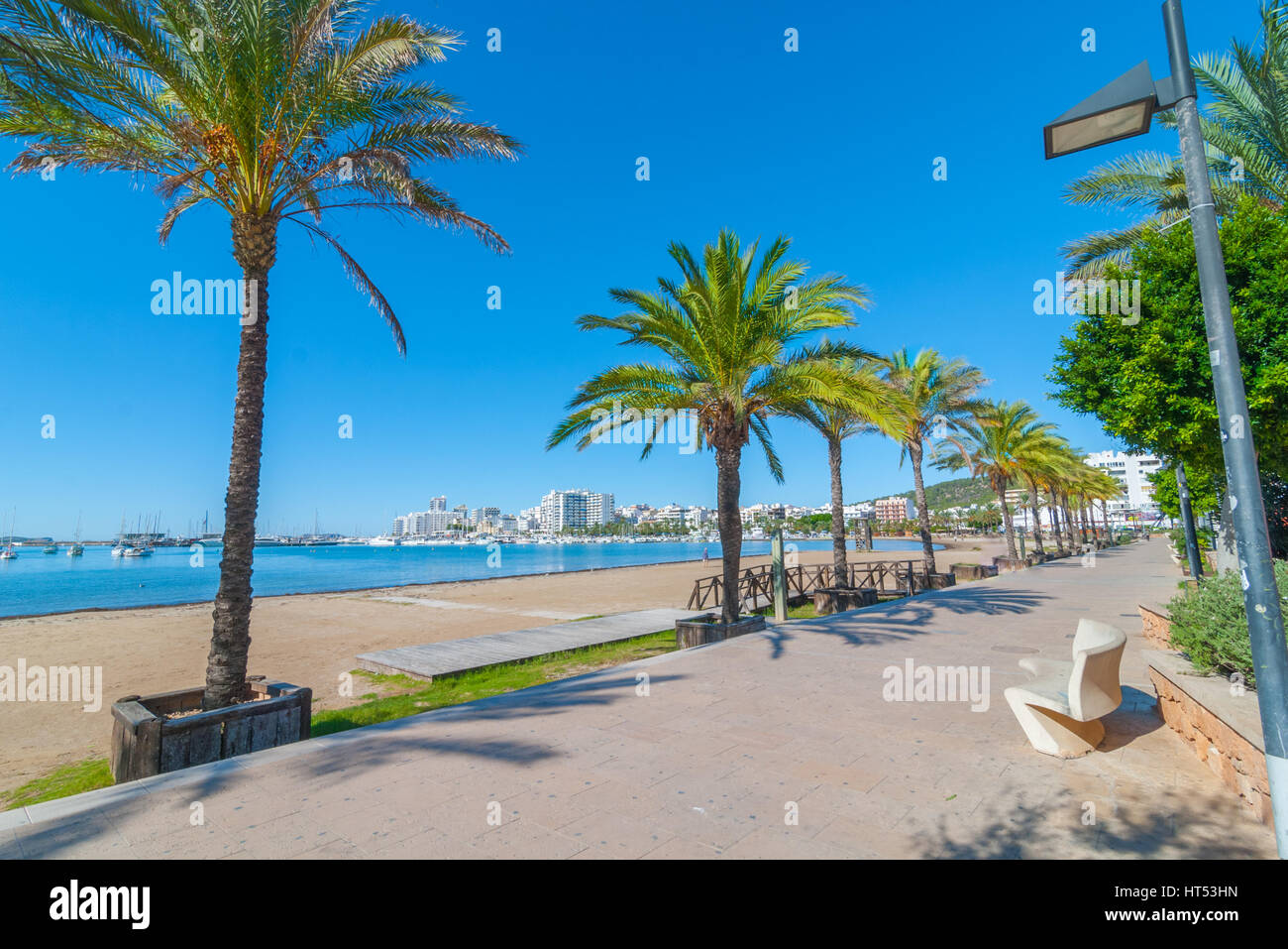 Ibiza sunshine on the waterfront in Sant Antoni de Portmany,  Take a walk along the main boardwalk, now a stone - Stock Image