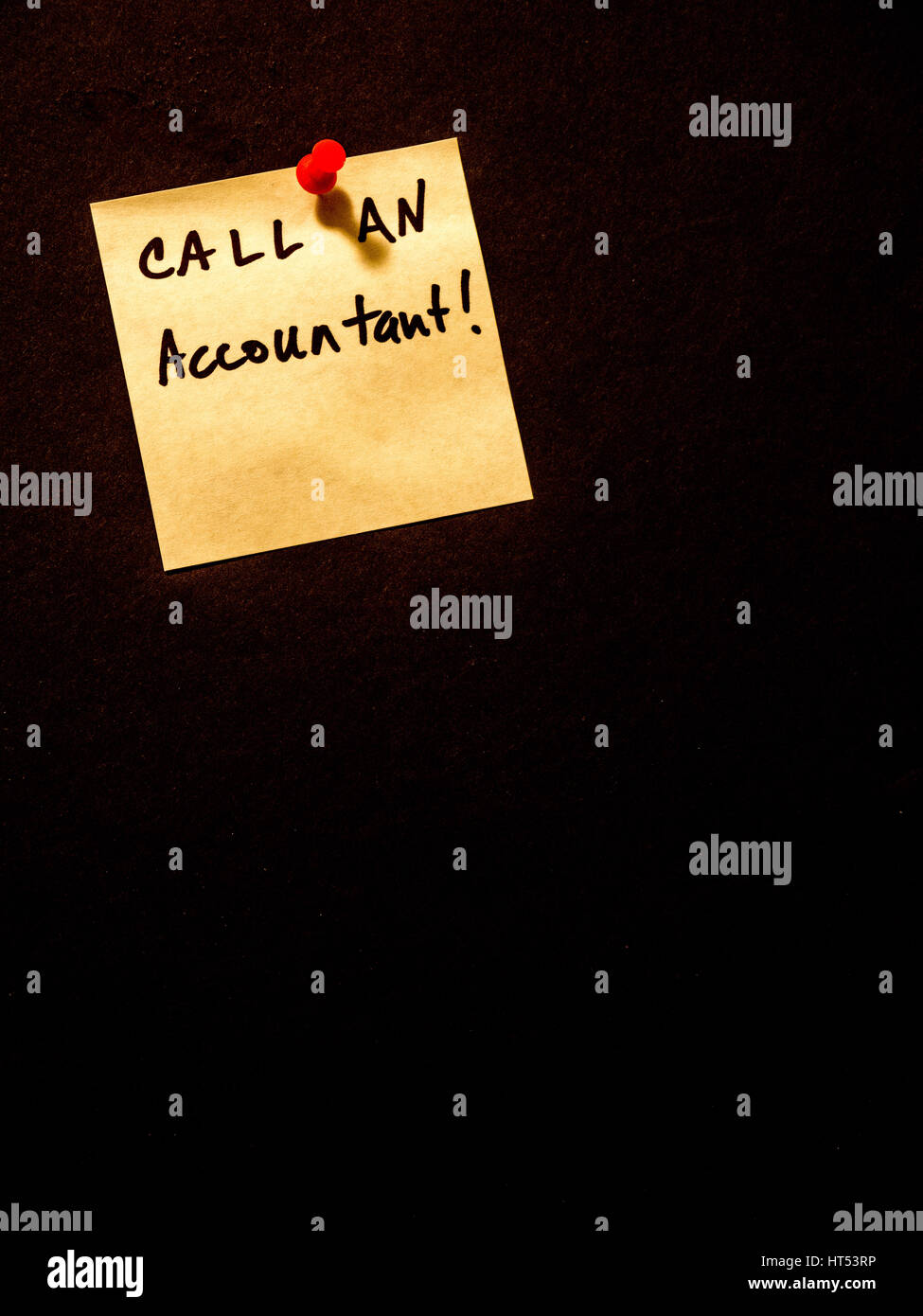 call an accountant, post it note on black, portrait orientation - Stock Image