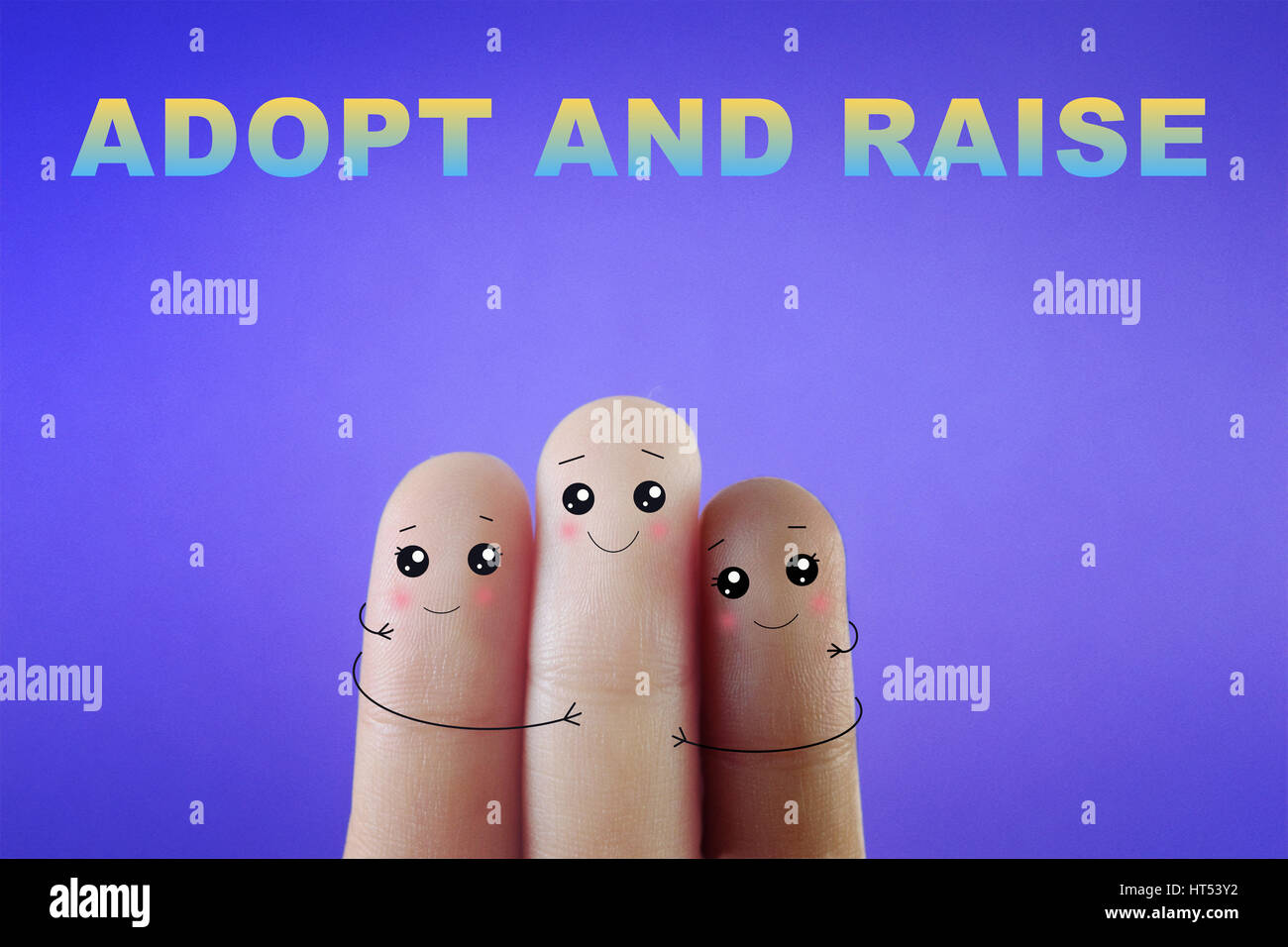 Three fingers decorated as a small happy  family. - Stock Image