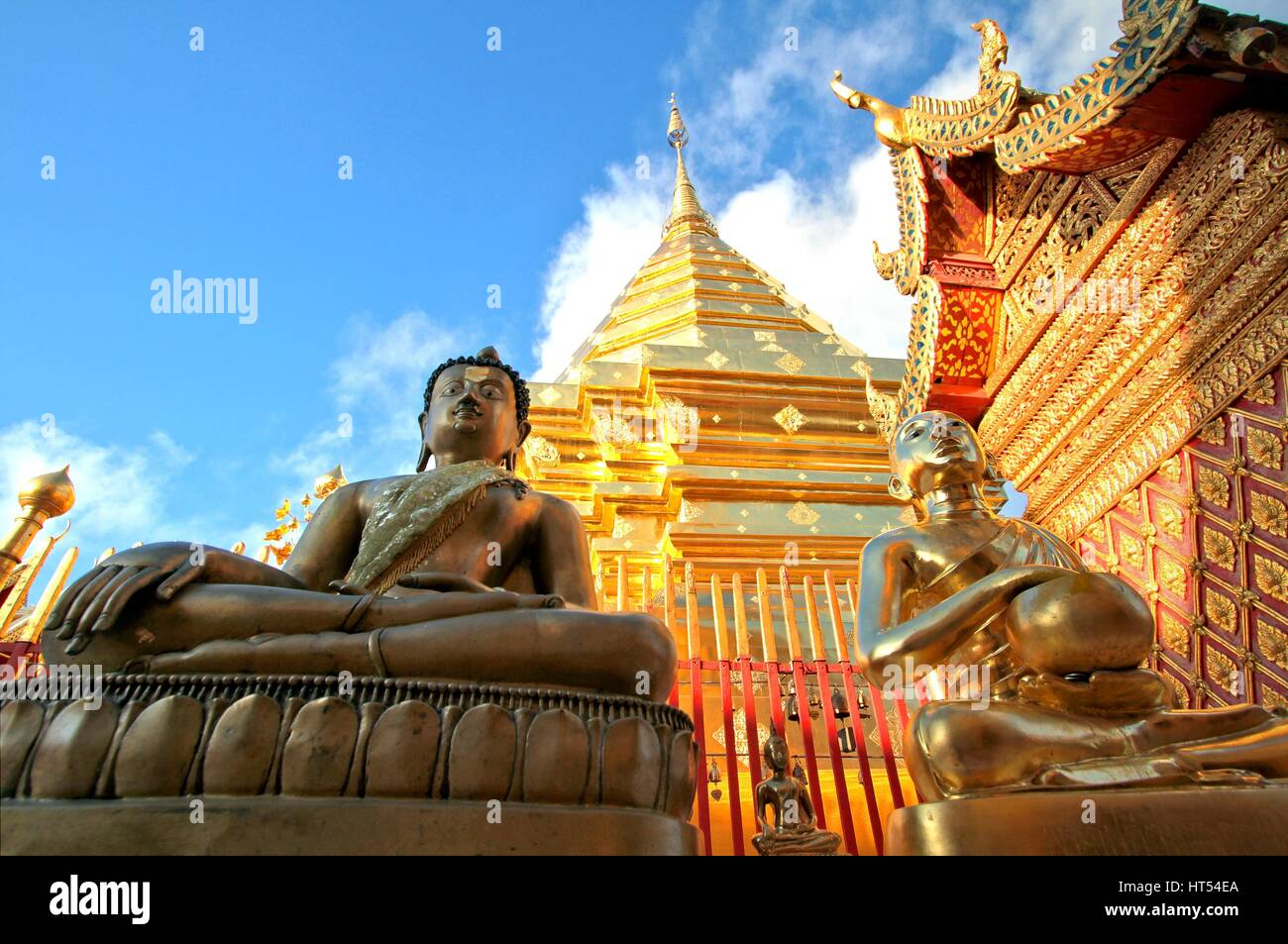 Buddha statues and golden pagoda against clear blue sky at Wat Phra That Doi Suthep, A famous Theravada buddhist - Stock Image