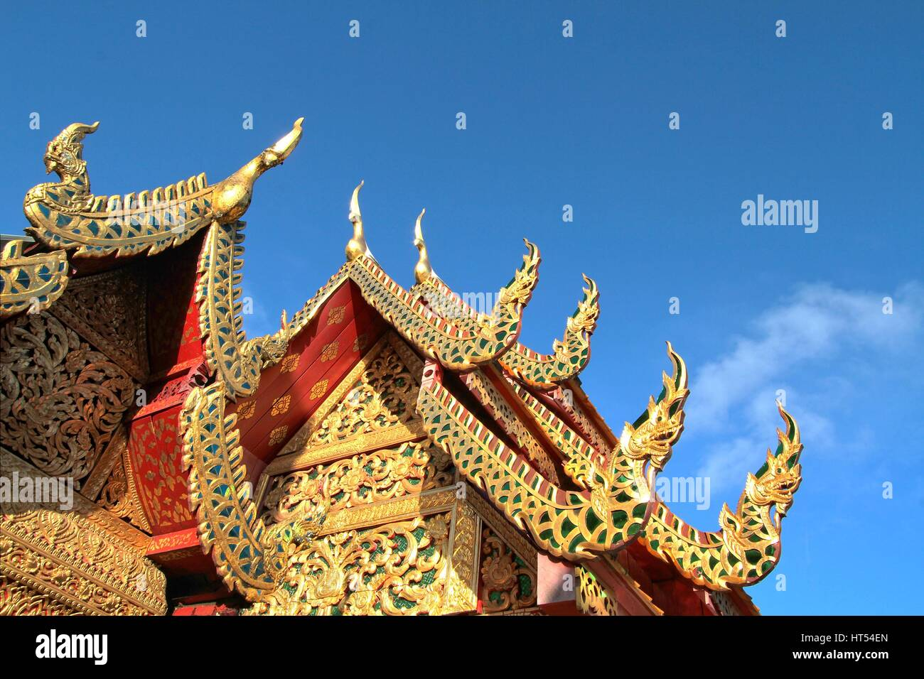 Details of northern style Thai temple roof against clear blue sky at Wat Phra That Doi Suthep, A famous Theravada - Stock Image