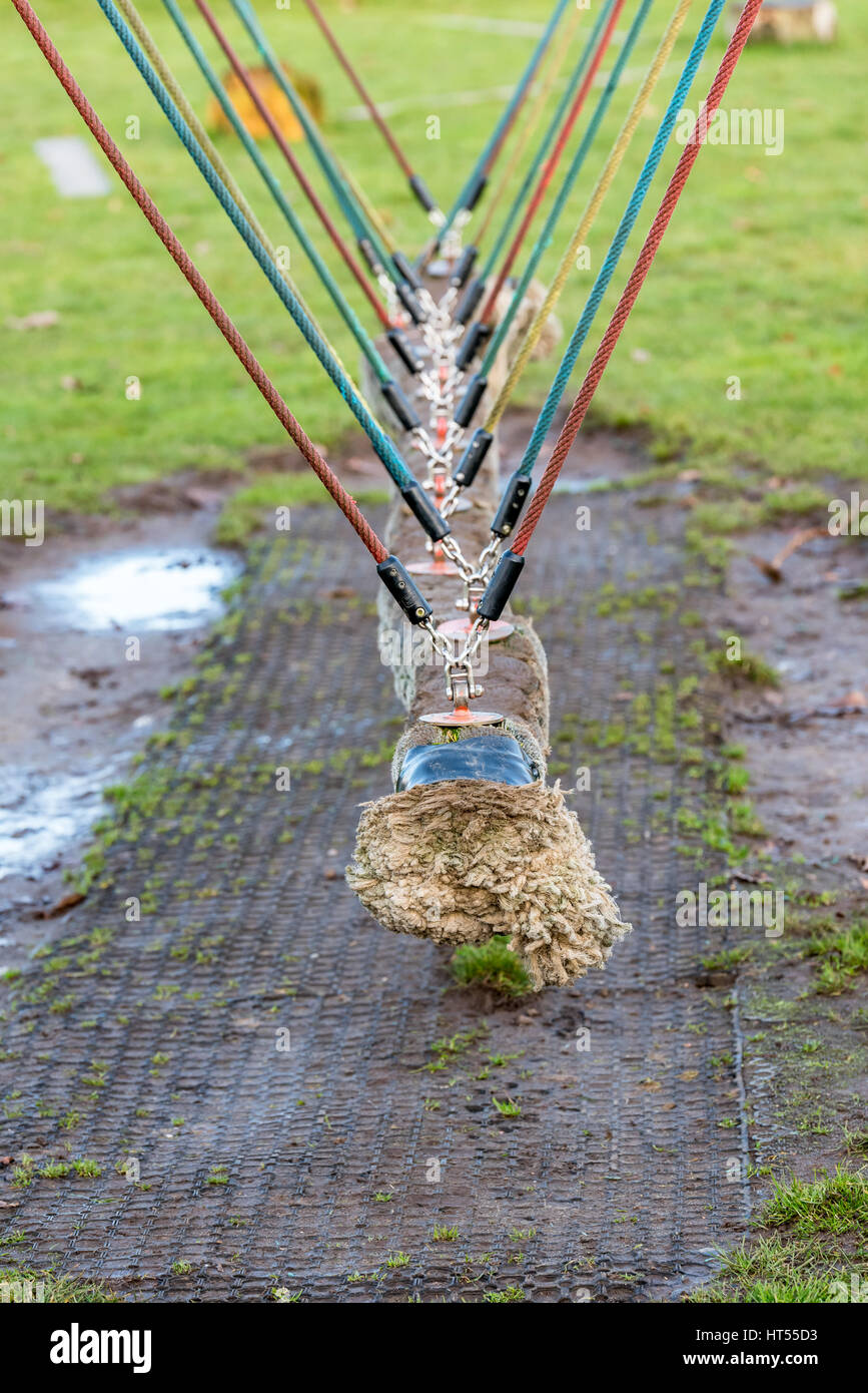 Swinging snake at children playground in spring. - Stock Image