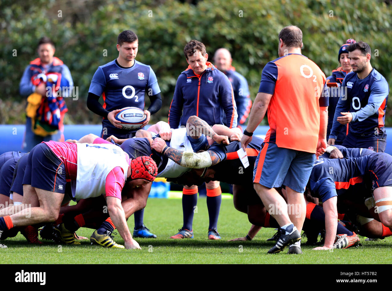 England players practice scrums during the training session at Pennyhill Park, Bagshot. - Stock Image