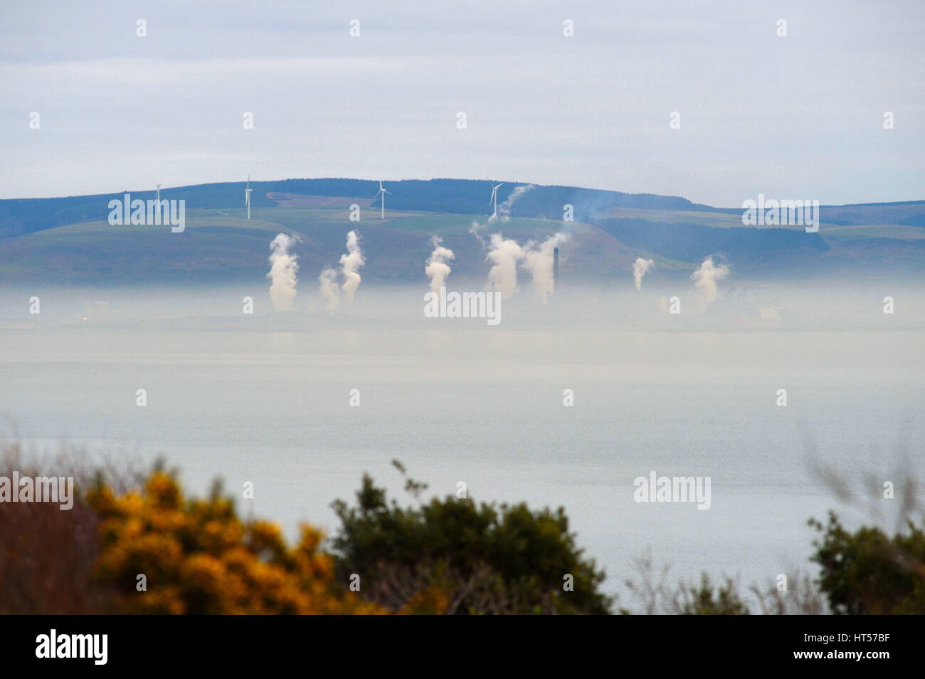 Polluted colder air from M4 traffic  combined with emissions from the steel works becomes trapped on low lying coastal - Stock Image