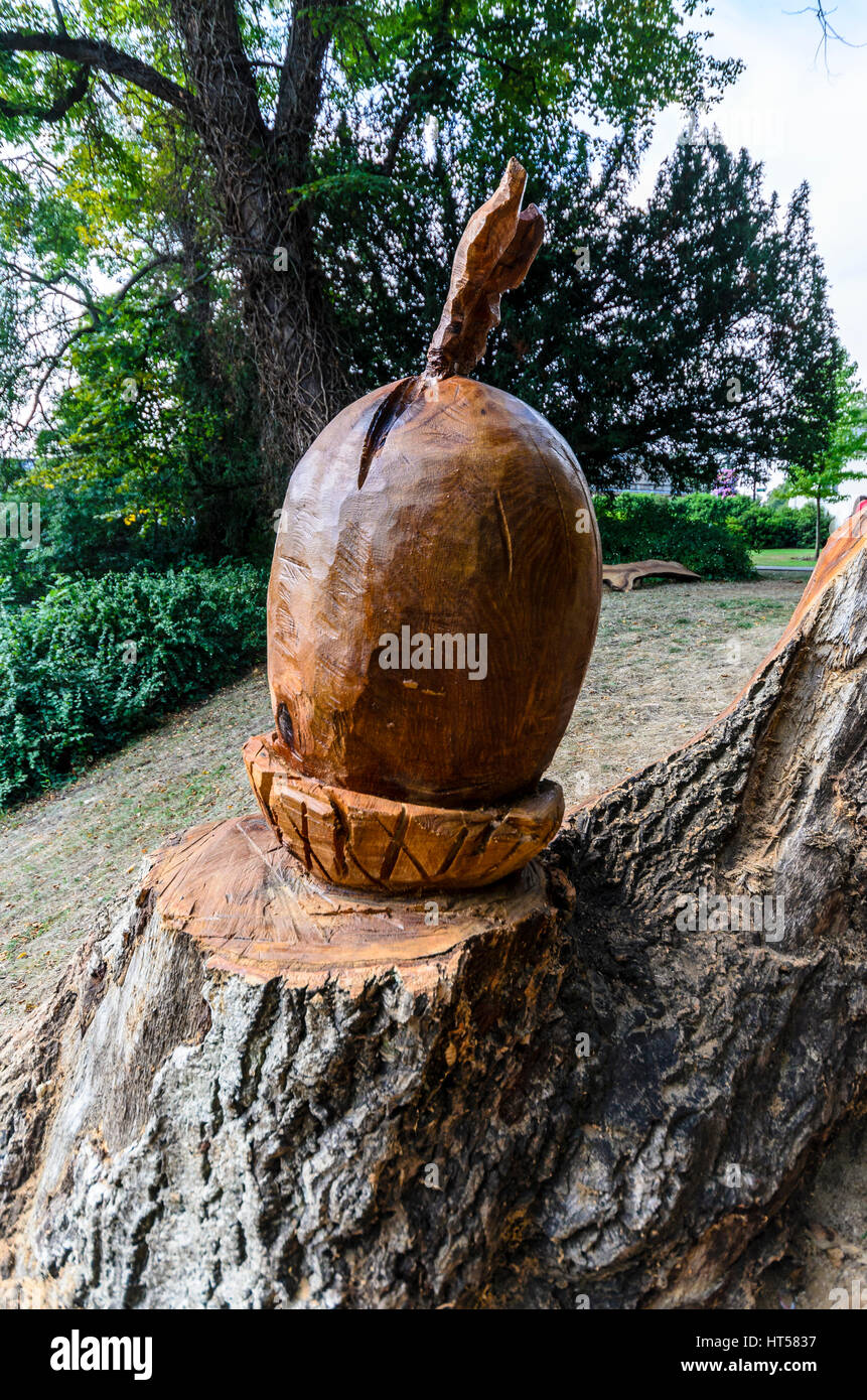 wooden sculptures in a park - Stock Image