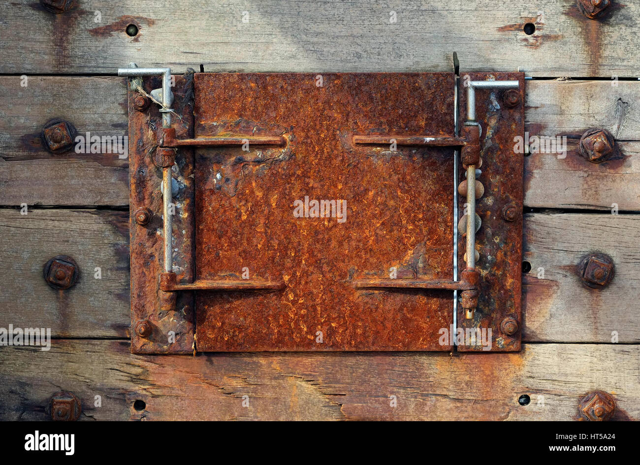 Ordinaire Rusted Metal Hatch Door On Weathered Timber Groyne   Stock Image