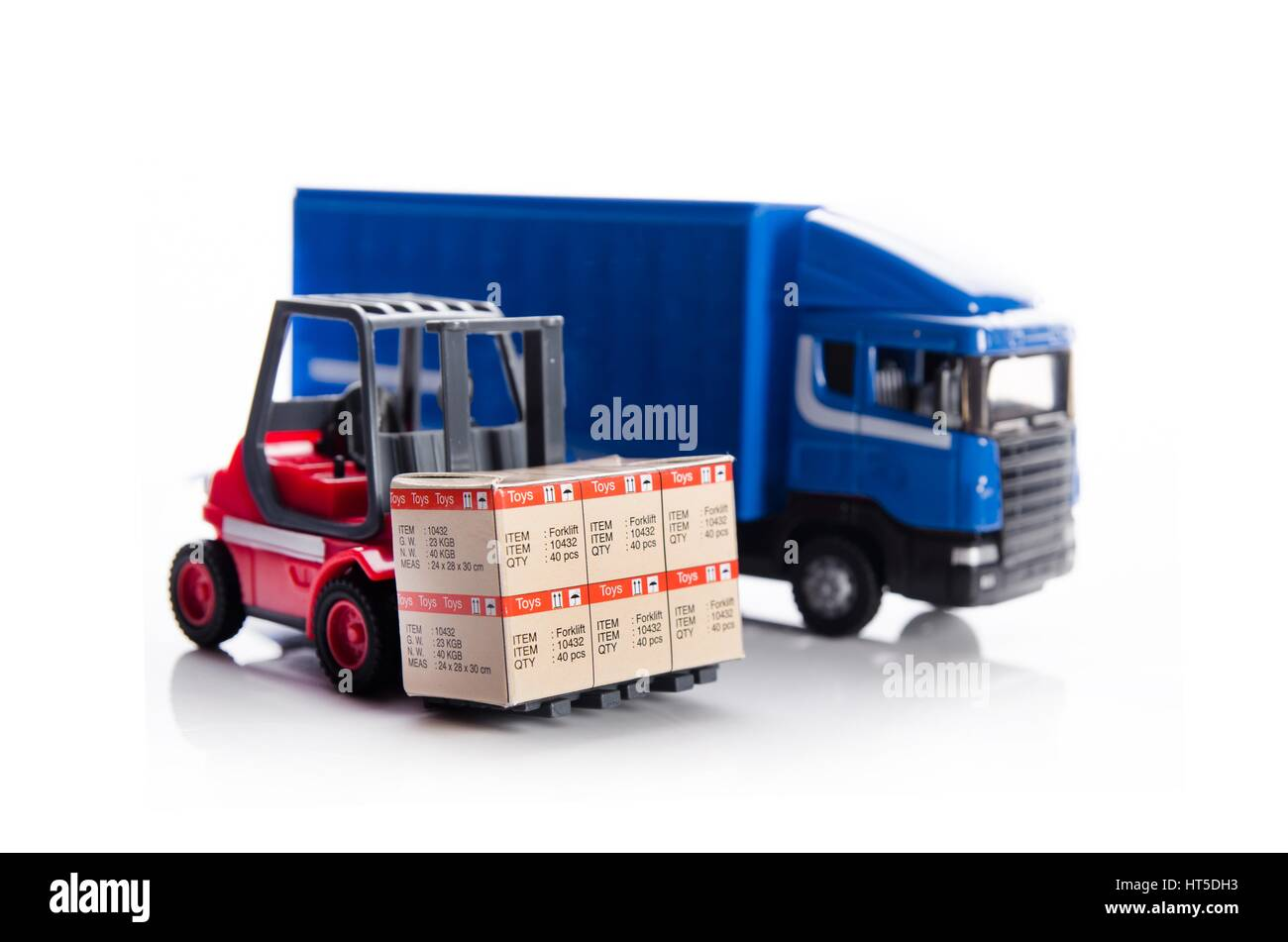 Forklift truck toys with boxes. Concept of international freight transport - Stock Image