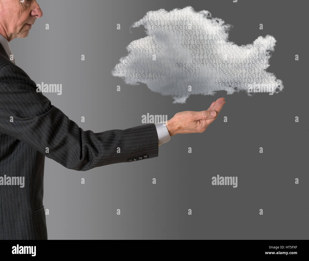 Senior male caucasian executive with floating cloud computing shape. Connection to electronic records via WiFi to Stock Photo
