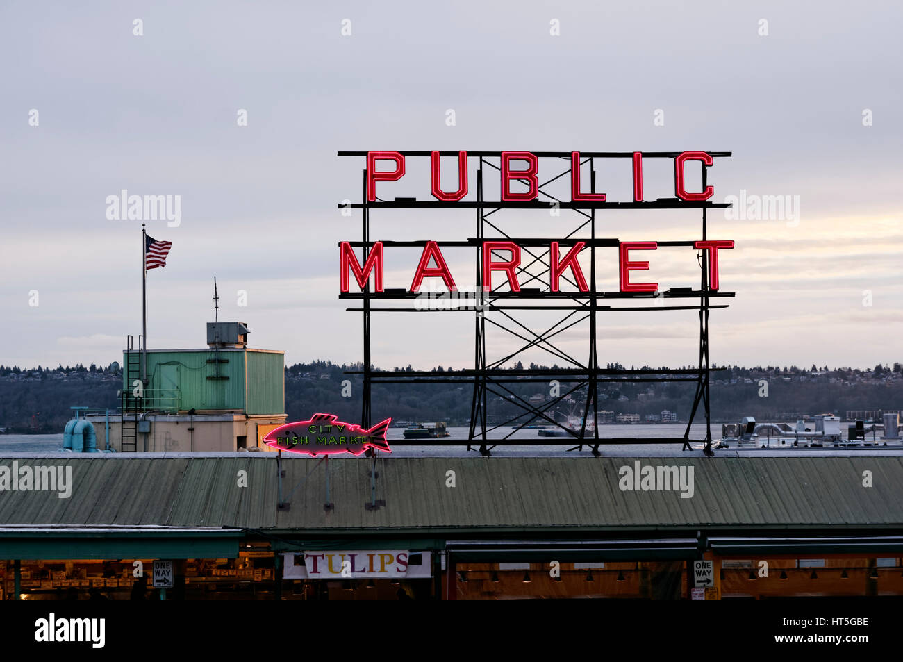 Pike Place Public Market and City Fish Market neon signs at dusk, Seattle, Washington state, USA - Stock Image