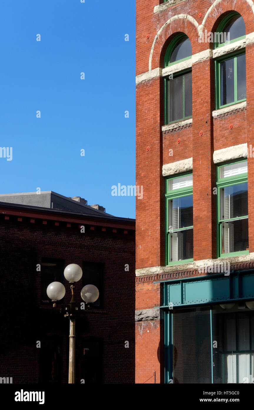 Street lanterns and facade of a Victorian red brick building in the historical Pioneer Square district of Seattle, - Stock Image