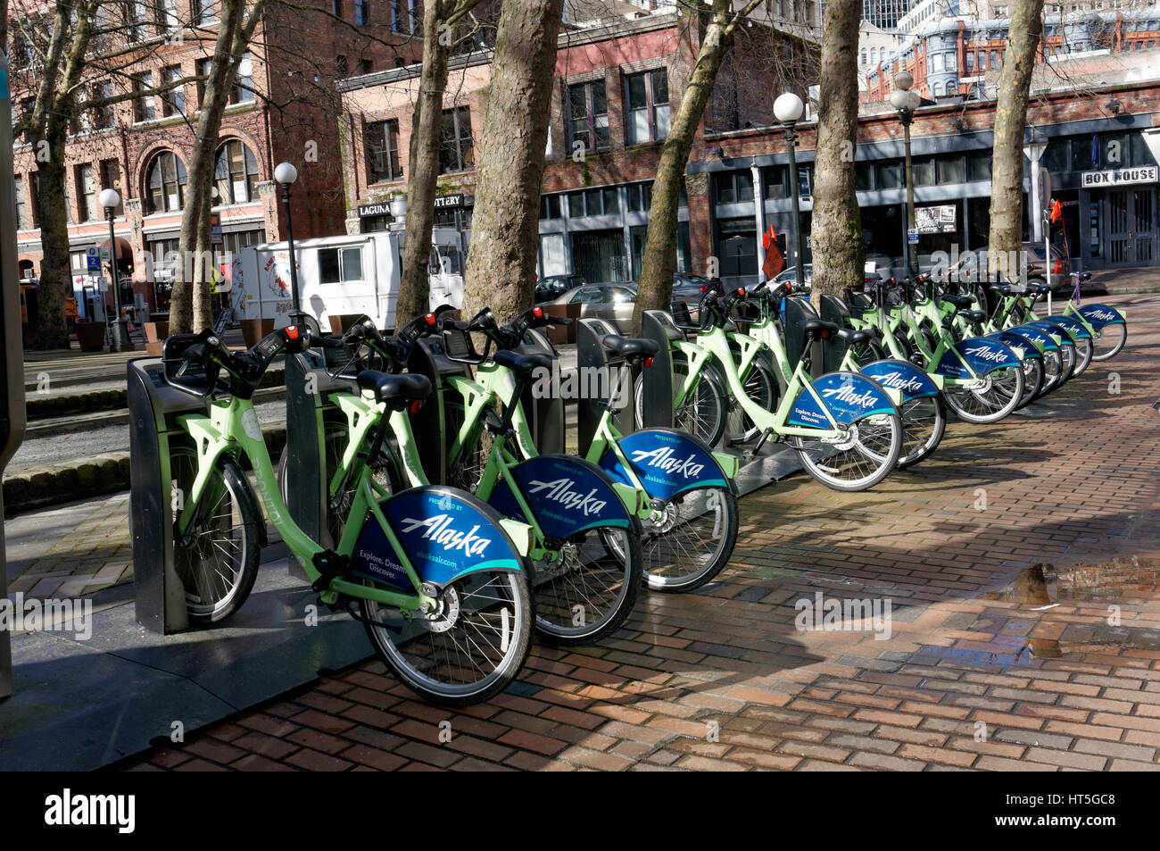 Bicycles parked at a bike-sharing station in Occidental Square Park in the Pioneer Square district of Seattle, Wa, - Stock Image