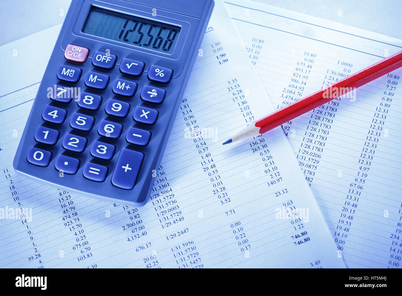 operating budget calculator and pencil in closeup stock photo