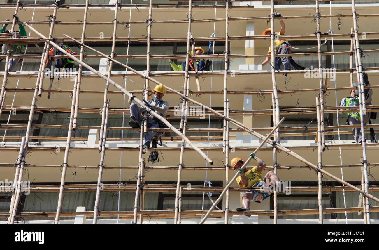 China, Hong Kong, construction site, workers, bamboo scaffolding, Stock Photo
