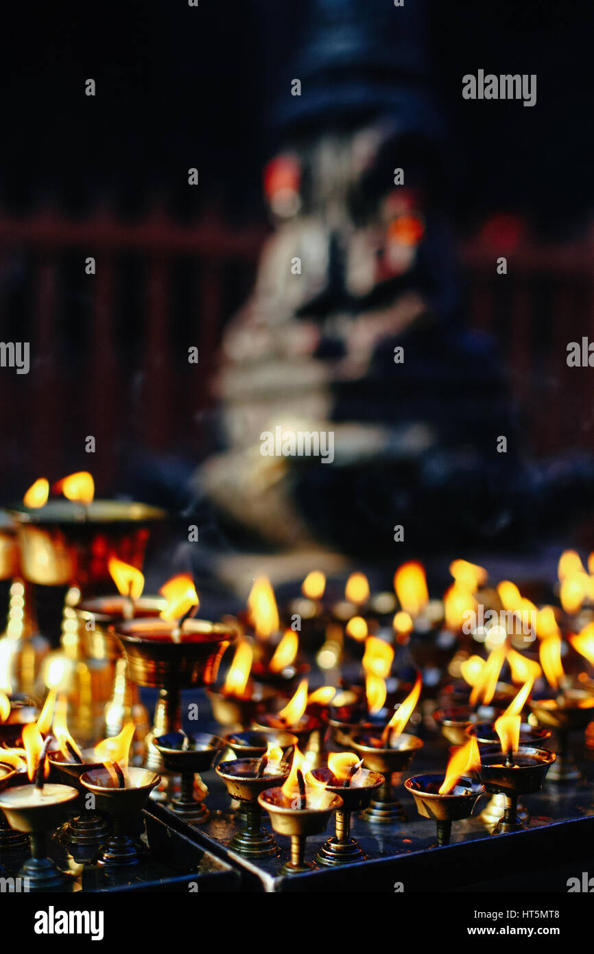 Oil lamps burning in the temple Stock Photo