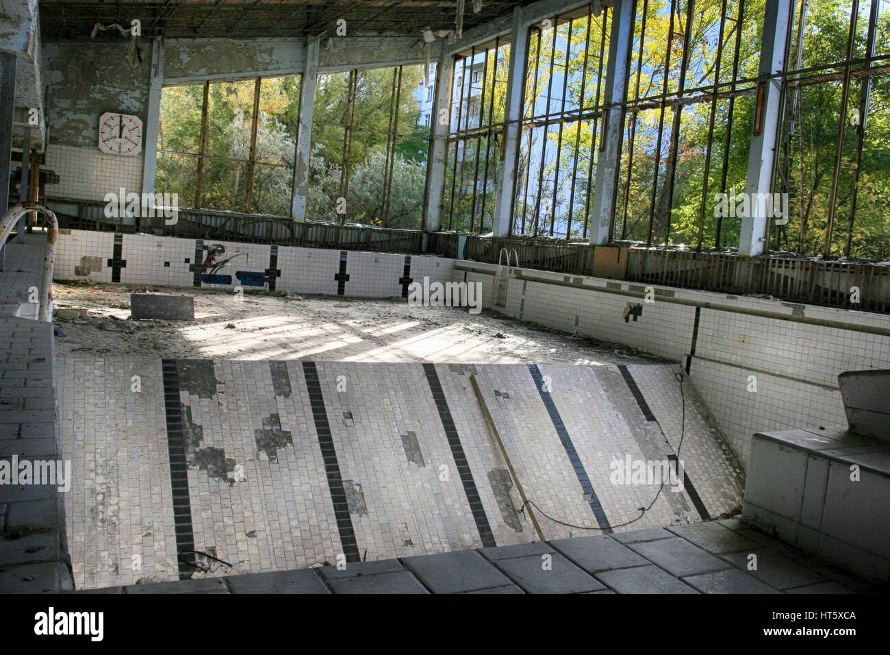 Abandoned swimming pool in Pripyat, the ghost town in the Chernobyl Exclusion Zone - Stock Image