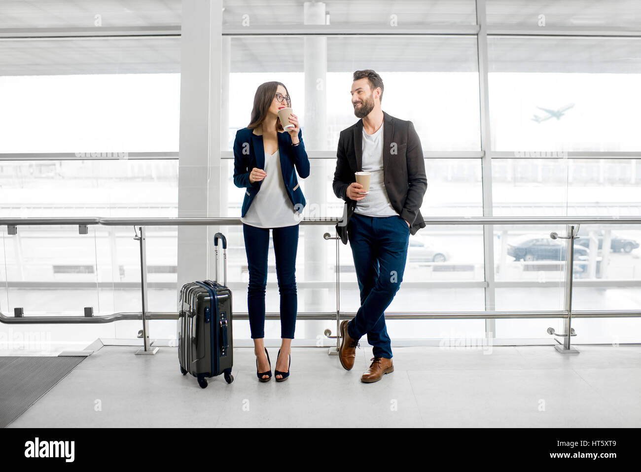 Business couple at the airport - Stock Image