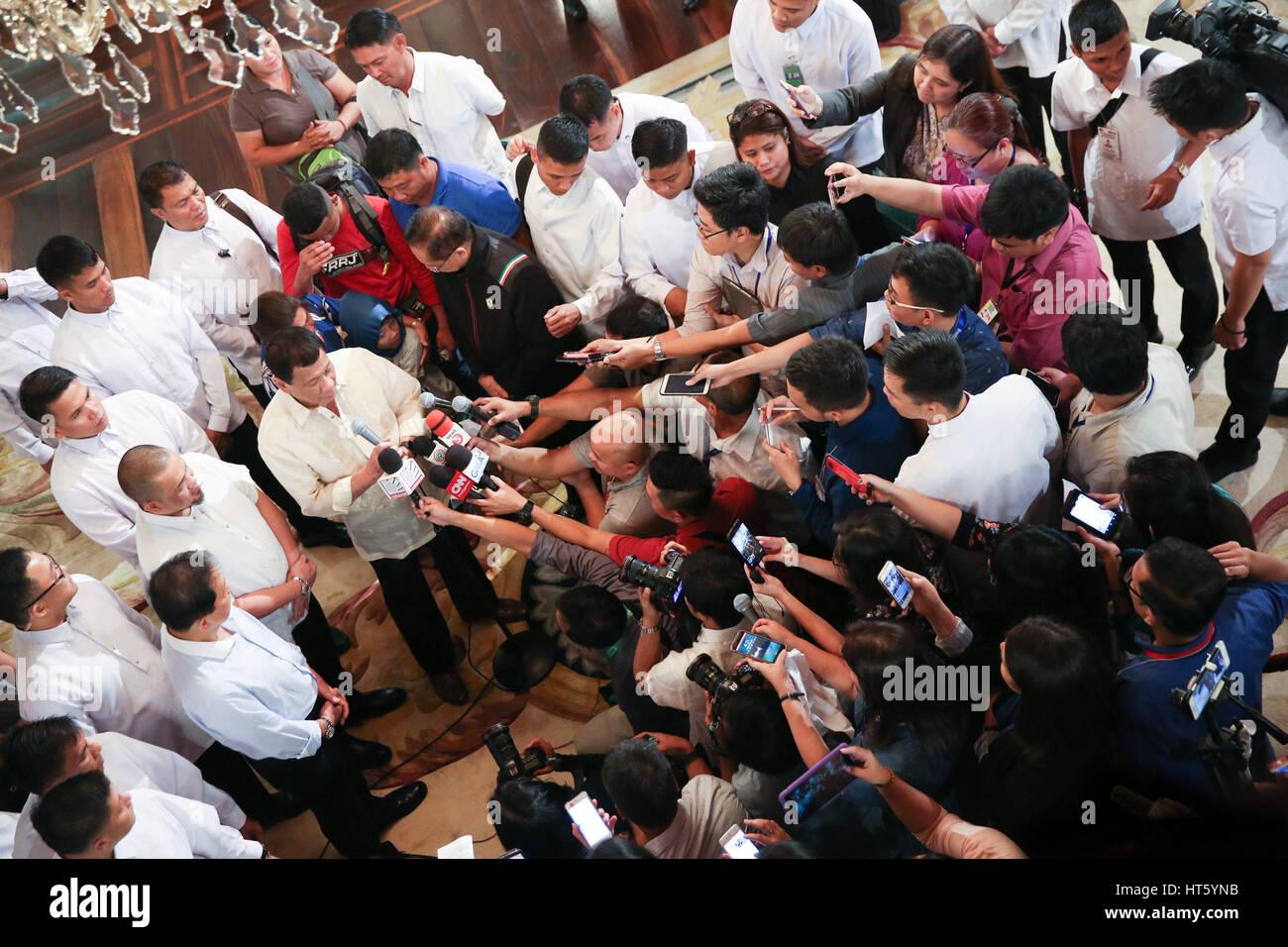 Philippine President Rodrigo Duterte addresses the media after reuniting kidnap victim Rexon Romoc and his parents - Stock Image