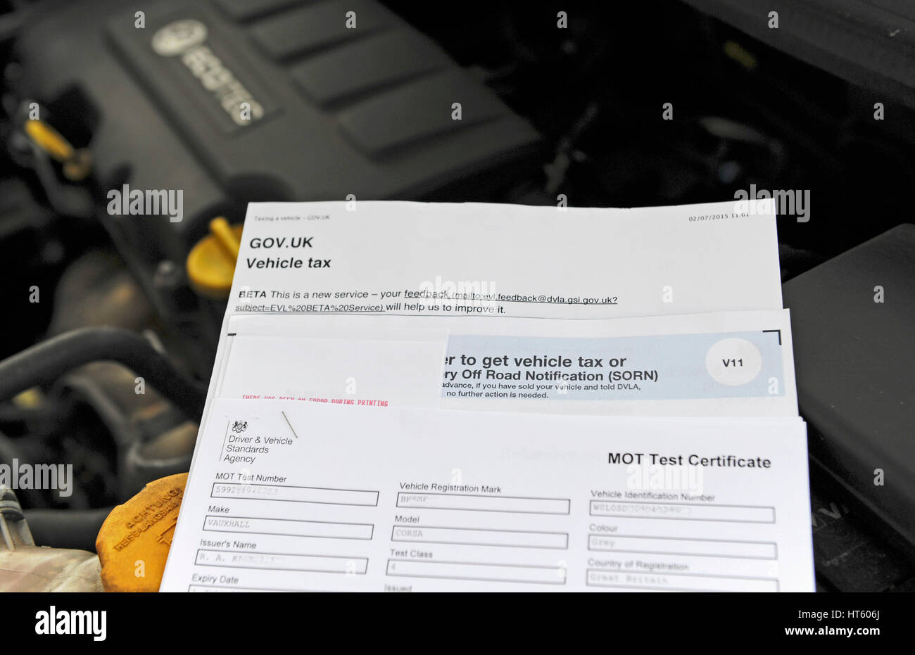 UK vehicle MOT test certificate and tax renewal form - Stock Image