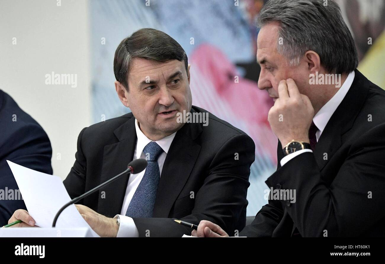 Russian Presidential Aide Igor Levitin, left, and Deputy Prime Minister Vitaly Mutko before the start of a meeting - Stock Image