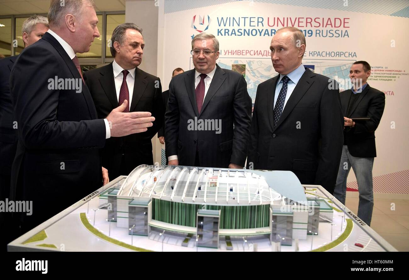 Russian President Vladimir Putin is show a scale model of the sports complex being built before the start of a meeting - Stock Image
