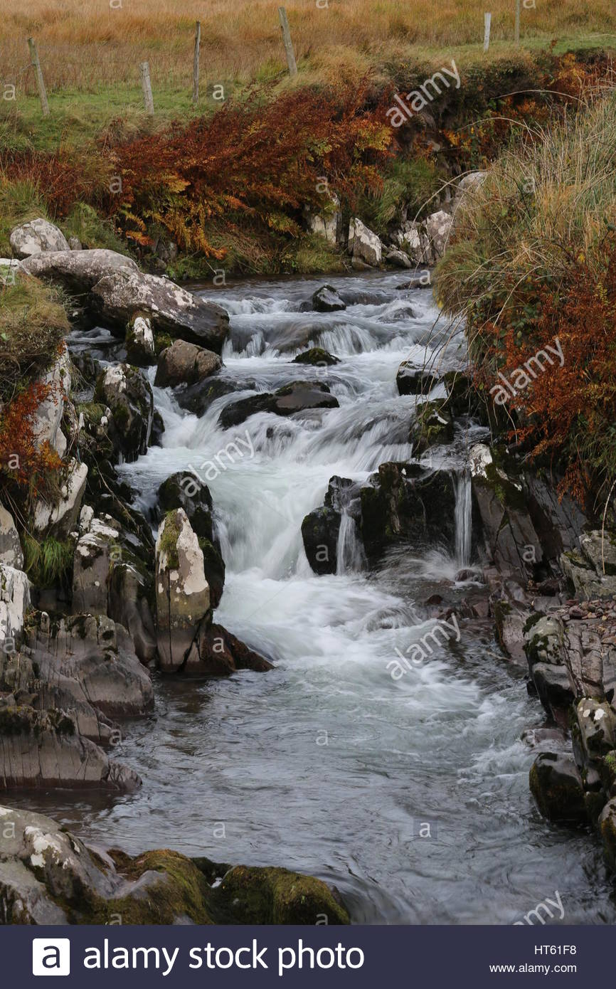 A stream rushing to the Atlantic Ocean at Brandon Creek,County Kerry, Ireland - Stock Image