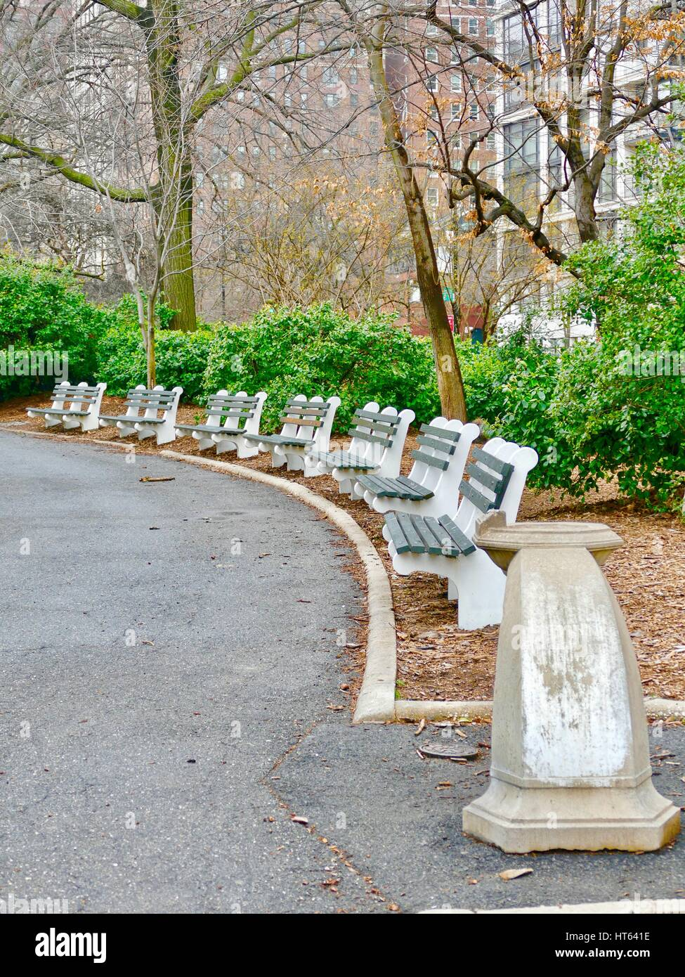 Green and white public benches, New York, New York, USA. Stock Photo
