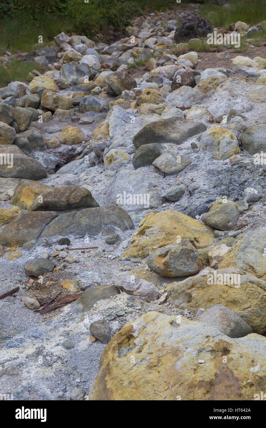 Stones stained with sulfur in the monterano natural - Stock Image