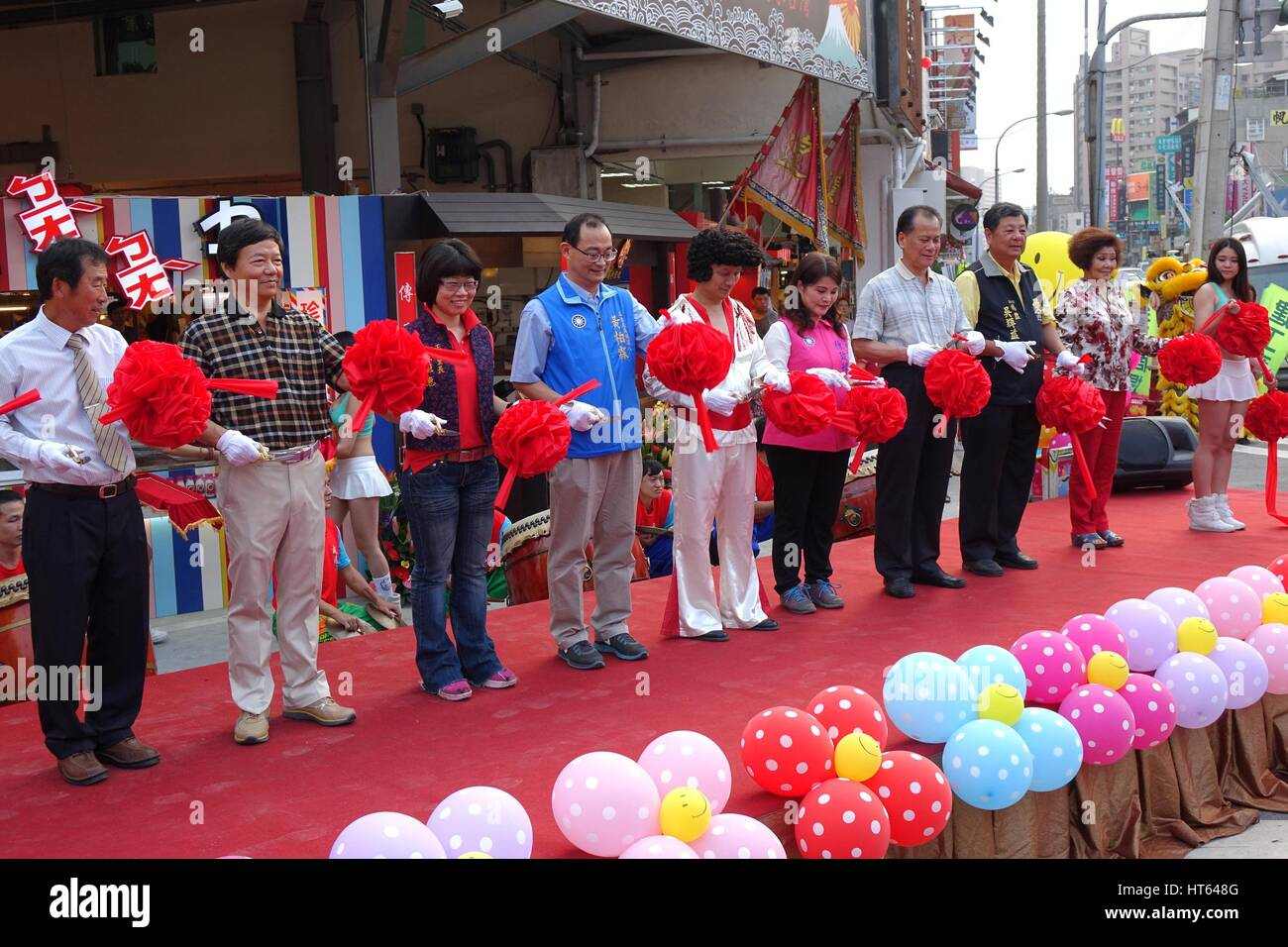 KAOHSIUNG, TAIWAN -- NOVEMBER 20, 2015: Local politicians and businessmen perform the ribbon cutting ceremony at - Stock Image