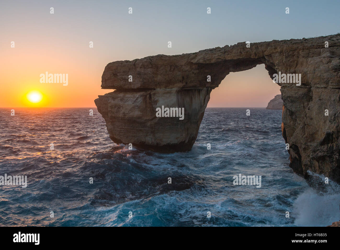 The Azure Window with waves at sunset on Gozo, Malta - Stock Image