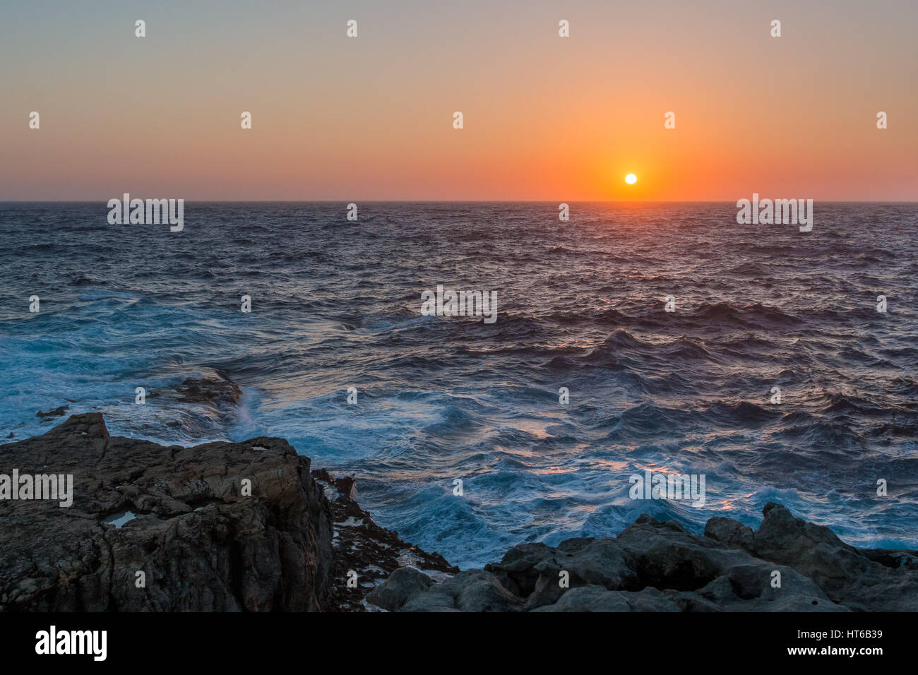 Sunset over the Mediterranean from Gozo, Malta - Stock Image