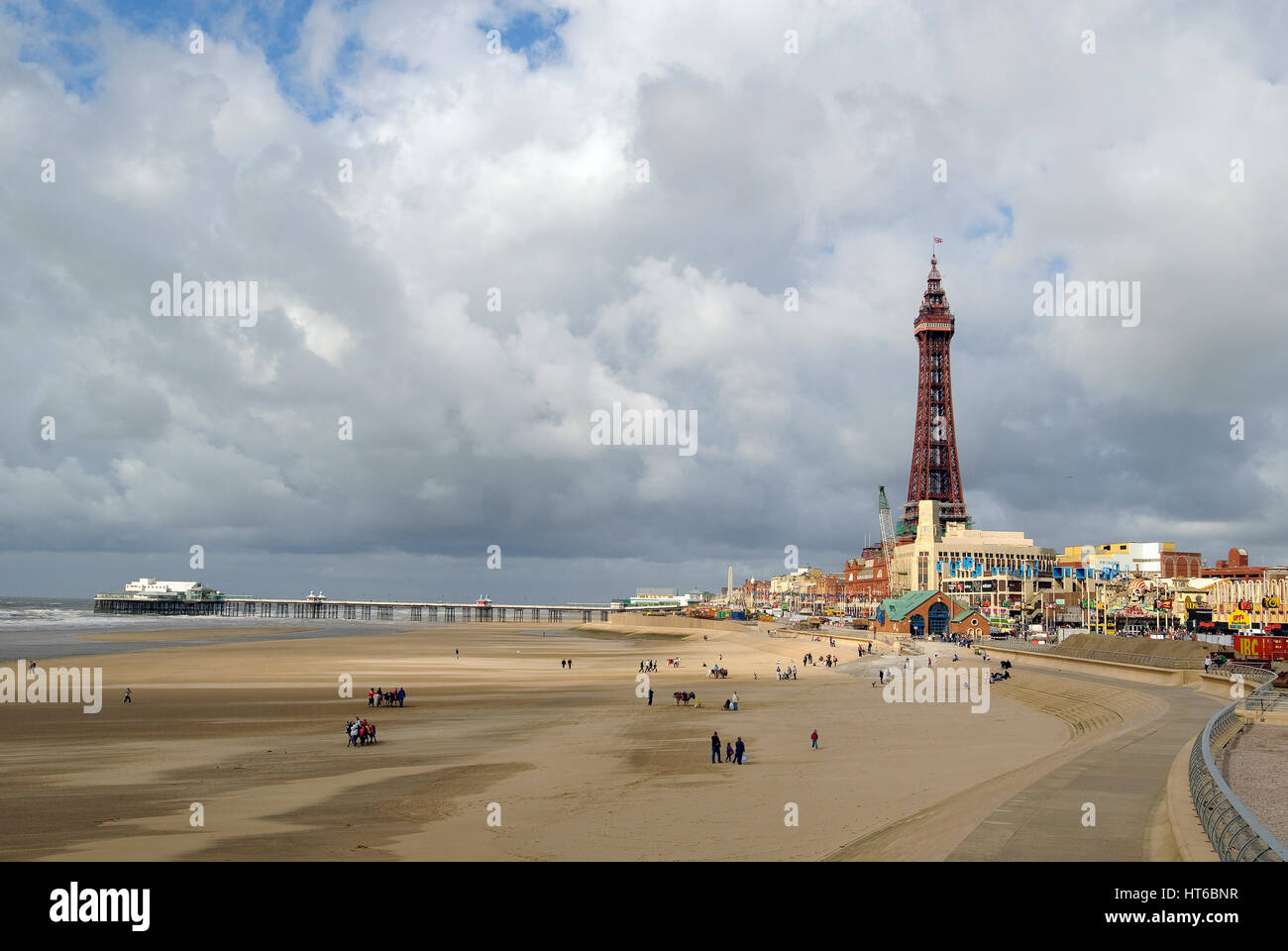 Blackpool tower pier beach waves Golden Mile. - Stock Image