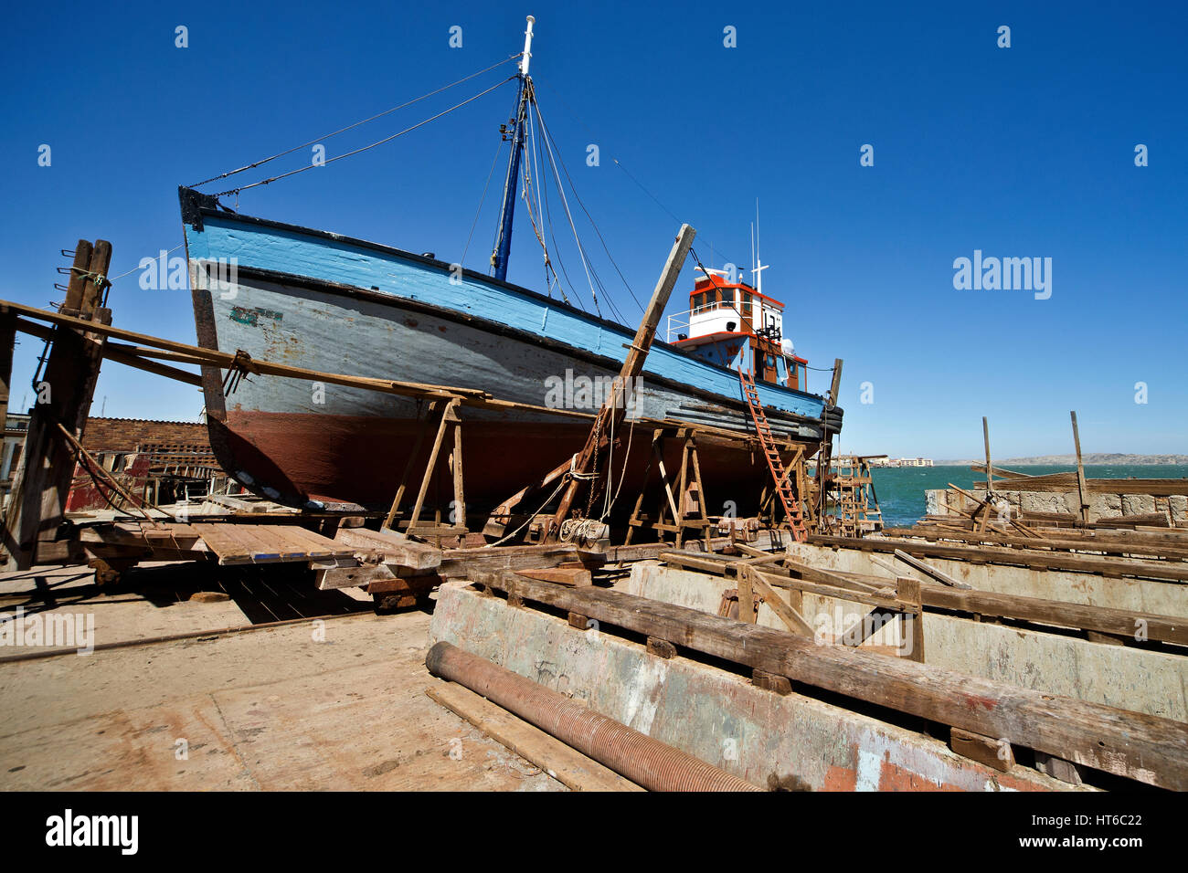 Fishing boat on the hard at Luderitz being refurbished - Stock Image