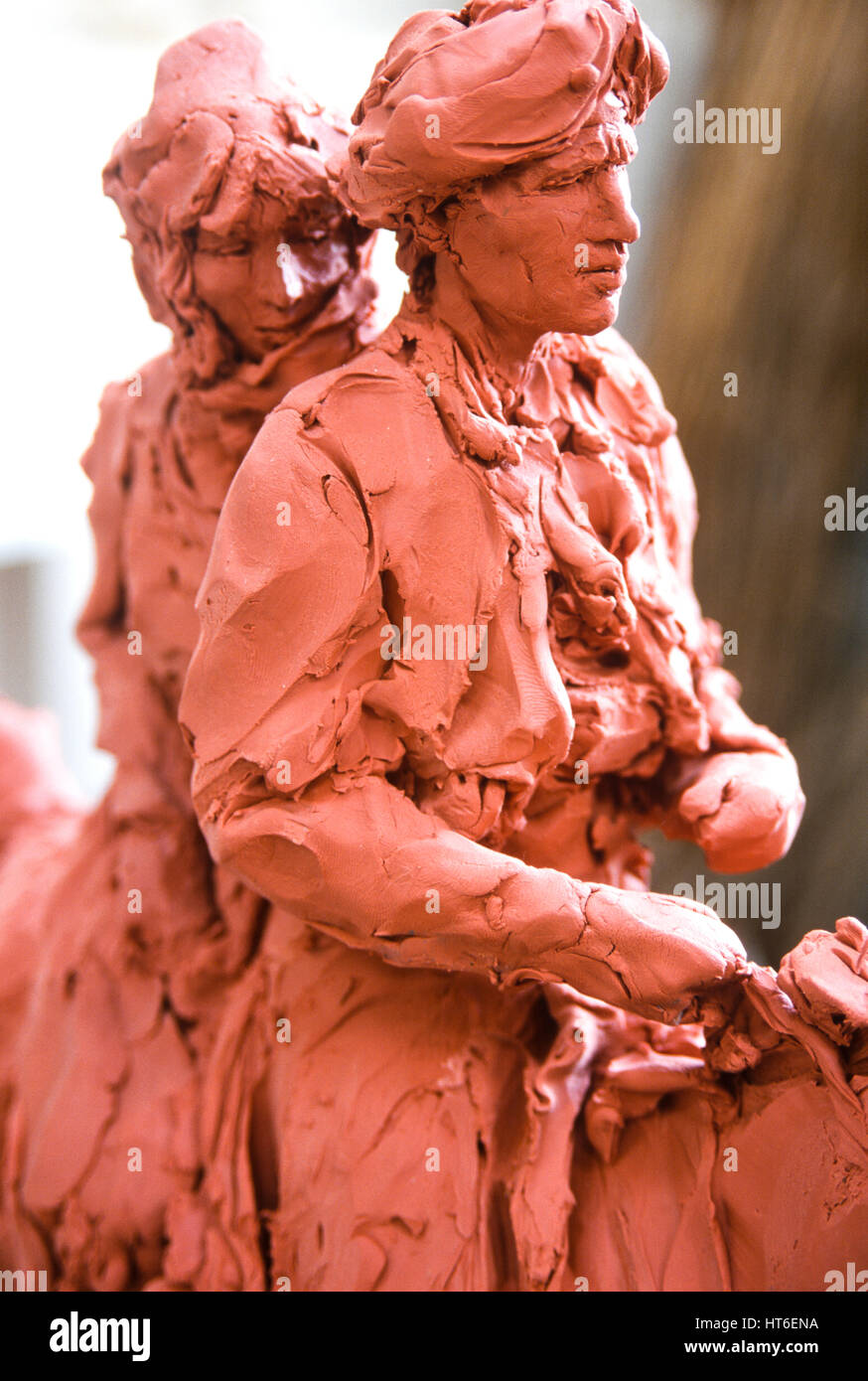 Clay sculpture of a man and woman. - Stock Image