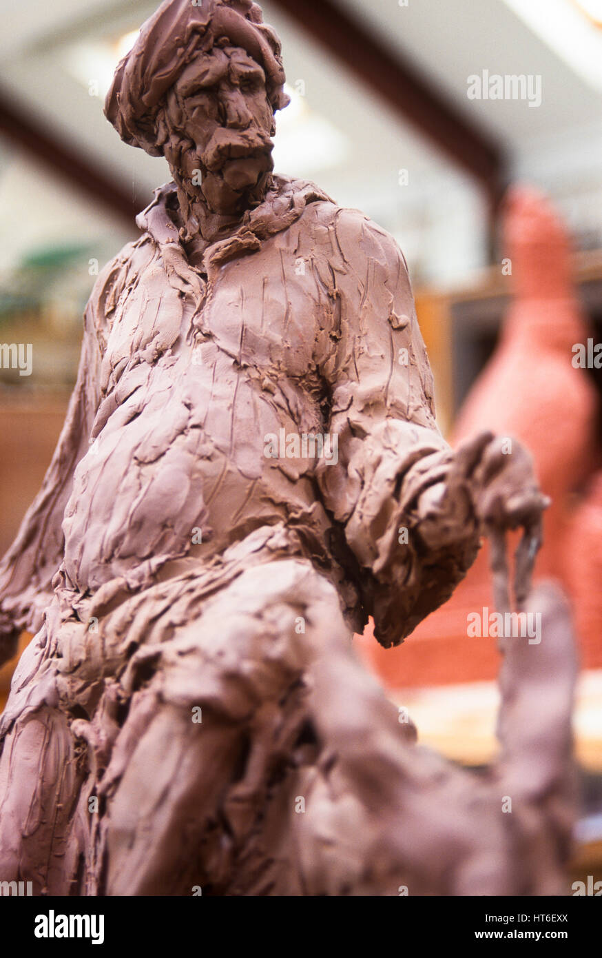 Clay sculpture of a man. - Stock Image
