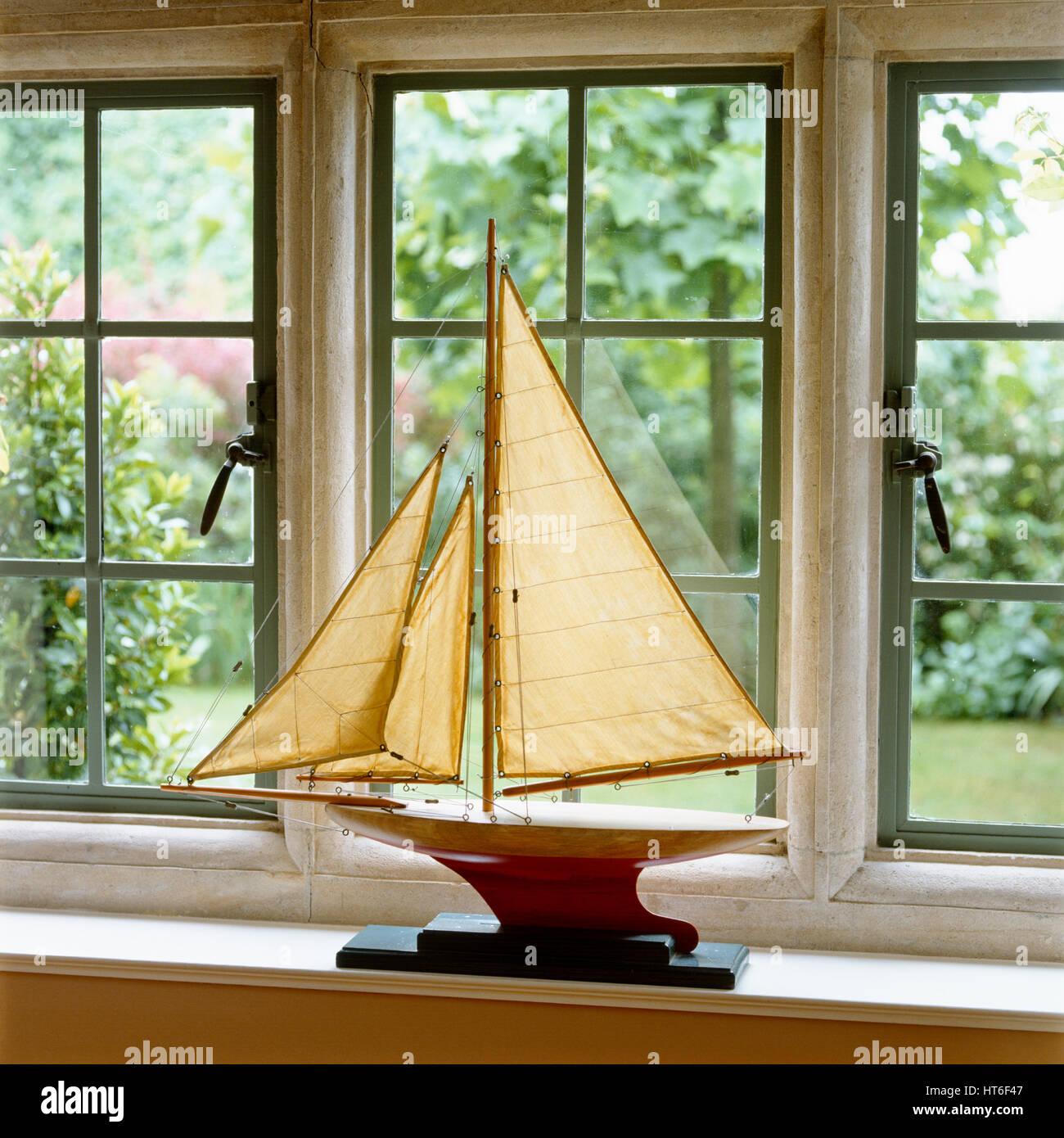 Model sailboat on windowsill. Stock Photo
