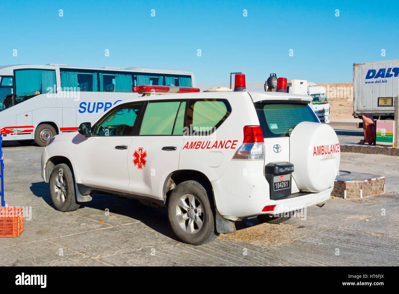SUV ambulance, Petrom Sahara service station, N1 road, between Boujdour and Dakhla, Western Sahara, administered - Stock Image