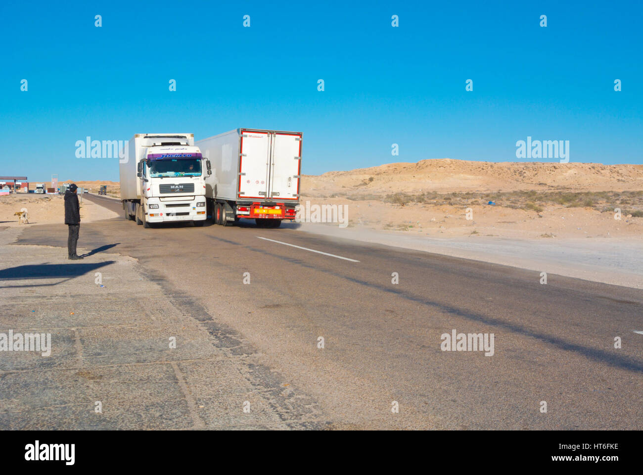 Trucks, N1 road, between Boujdour and Dakhla, Western Sahara, administered by Morocco, Africa - Stock Image