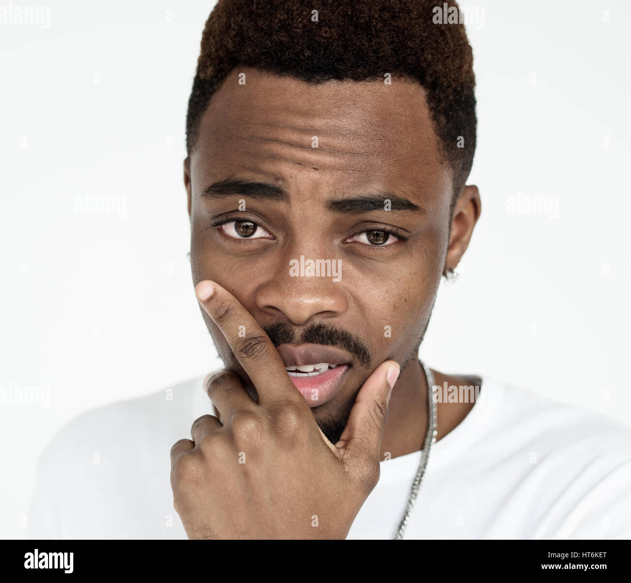 Young black guy sultry pose hand on face - Stock Image