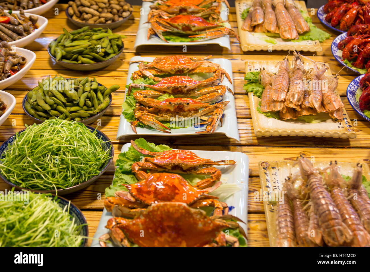 Crabs and various kinds of seafood offered in night food market - Stock Image