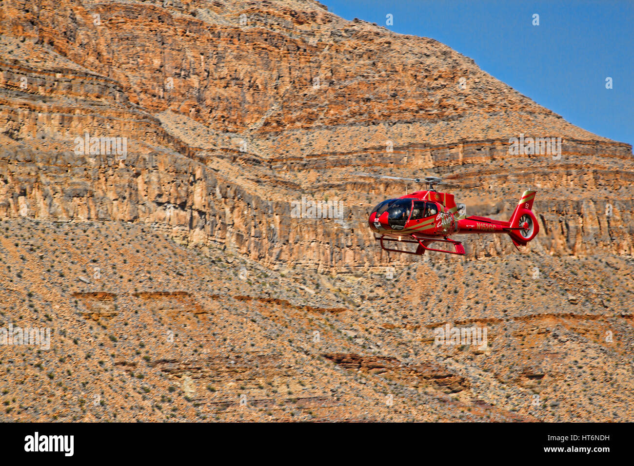Helicopter Landing on the Floor of The Grand Ganyon Next to the Colorado River - Stock Image
